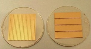Photograph of two faces on 0.5 mm thick TlBr detectors with orthogonal strip design. The area covered by both sets of strips is 10x10mm2. One set of strips provides very high spatial resolution (0.5 mm pitch), while the coarser strips place orthogonally to the high resolution strips provide DOI.
